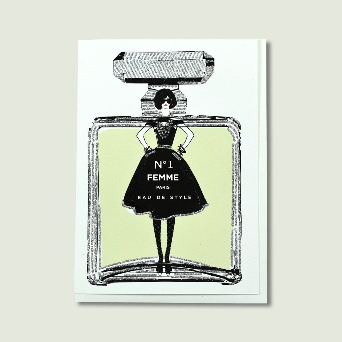 Picture of a card that features a girl on a perfume bottle