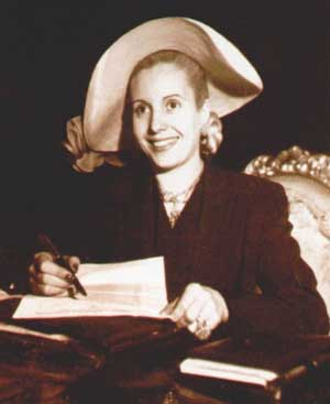 Picture of Eva Perón writing in a stylish hat