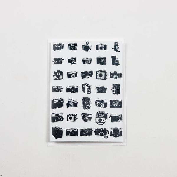 Picture of a card that features vintage cameras