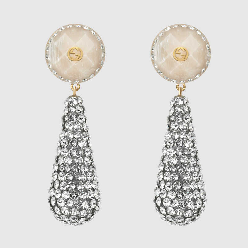 Picture of crystal-studded drop pendant earrings by Gucci