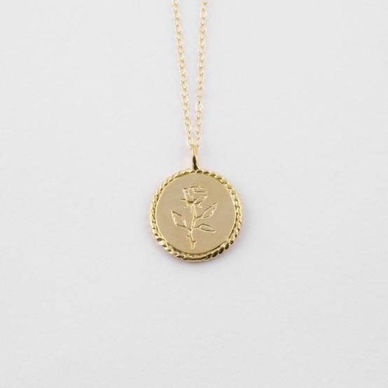 Picture of a rose coin necklace from Local Eclectic by Wolf Circus